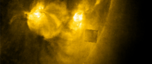 massive cube exiting sun caught in nasa soho image